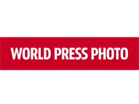 World Press Photo of the Year 2015 awarded for moonlight migrant portrait