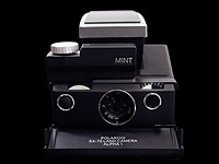 MINT SLR670-S Noir is a refurbished Polaroid SX-70 with added auto modes