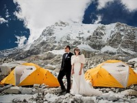 Photographer takes wedding photos at the top of the world