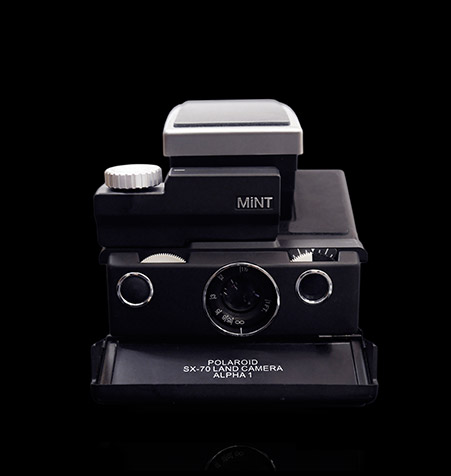 MINT SLR670-S Noir is a refurbished Polaroid SX-70 with added auto modes 1