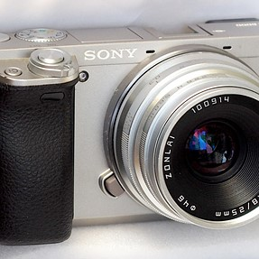 Manual, but still interesting lens - 25mm f1.8 and hopefully not expensive. Comes in native E-mount!
